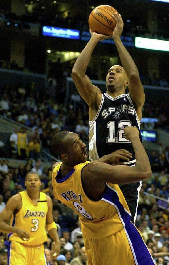 The Spurs' Bruce Bowen shoots Thursday night May 15, 2003 at the Staples Center in Los Angeles over a surprised Kobe Bryant during the 6th game of the best-of-seven Western Conference Semi-finals. The Spurs won 110-82 to advance to the conference finals.   (WILLIAM LUTHER/STAFF) Photo: WILLIAM LUTHER, Express-News / SAN ANTONIO EXPRESS-NEWS