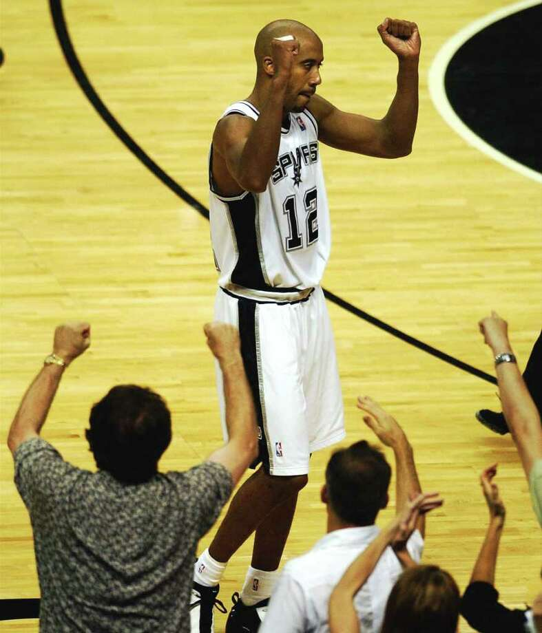 Spurs Bruce Bowen celebrates the Spurs narrow vistory over the Lakers as fans react also during Game 5 of the  Western Conference Semifinals at the SBC Center in San Antonio, TX Tuesday May 13, 2003.  PHOTO BY TOM REEL/STAFF Photo: TOM REEL, Express-News / SAN ANTONIO EXPRESS-NEWS