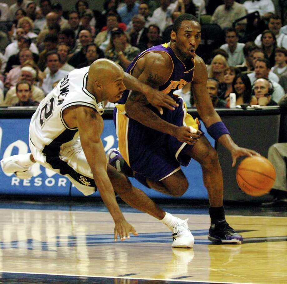 Lakers' Kobe Bryant (right) drives past Spurs' Bruce Bowen during second quarter of Game 5 of the Spurs against the Los Angeles Lakers in the Western Conference semifinals at the SBC Center in San Antonio on Thursday, May 13, 2004.  (Kin Man Hui/staff) Photo: KIN MAN HUI, Express-News / SAN ANTONIO EXPRESS-NEWS