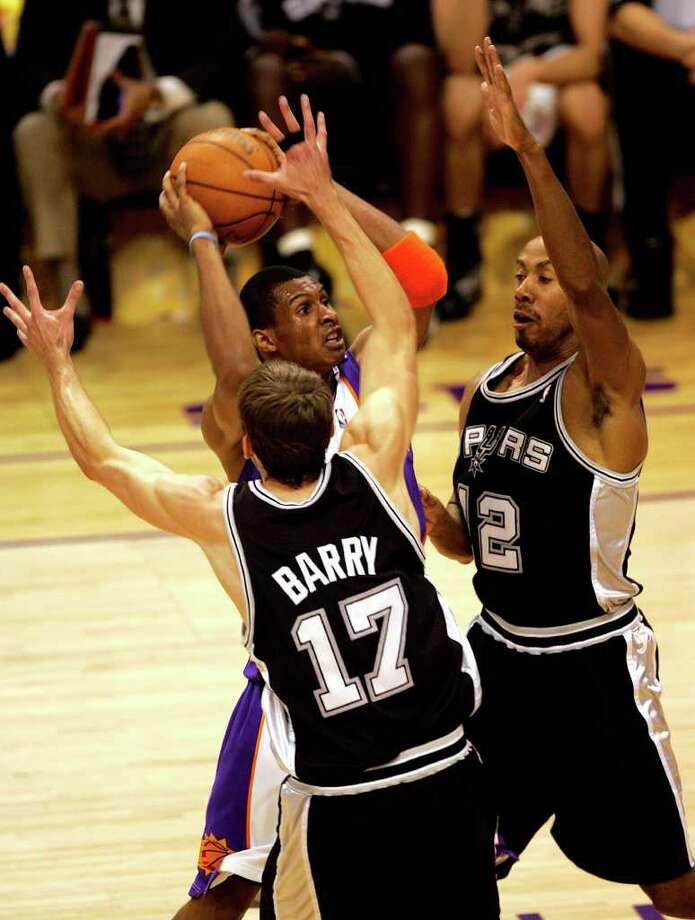 Spurs Brent Barry and Bruce Bowen defend Suns Leanardo Barbosa during second quarter action of the first game in the Western Conference Finals at  America West Arena  in Phoenix on Sunday, May 22, 2005. ( JERRY LARA STAFF ) Photo: JERRY LARA, Express-News / SAN ANTONIO EXPRESS-NEWS