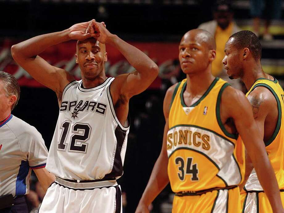 The Spurs' Bruce Bowen looks over at the Sonics' Ray Allen after Bowen was called for fouling Allen in game two of their Western Conference Semifinals Tuesday, May 10, 2005 a the SBC Center. BAHRAM MARK SOBHANI/STAFF Photo: BAHRAM MARK SOBHANI, Express-News / SAN ANTONIO EXPRESS NEWS