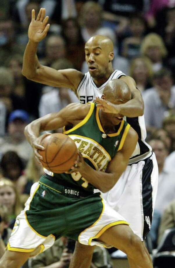 Spurs forward Bruce Bowen, right, defends  Seattle SuperSonics guard Ray Allen (34) during the second quarter in game one of their Western conference semifinals game in San Antonio, Sunday, May 8, 2005. San Antonio won, 103-81.(AP Photo/Eric Gay) Photo: ERIC GAY, Express-News / AP