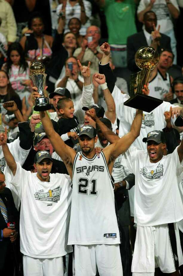 Spurs Tony Parker, left, Tim Duncan with both trophys and Bruce Bowen celebrate their NBA Championship during trophy presentation game 7 NBA Finals at the SBC Center in San Antonio Thursday June 23, 2005 . BAHRAM MARK SOBHANI/STAFF Photo: BAHRAM MARK SOBHANI, Express-News / SAN ANTONIO EXPRESS NEWS