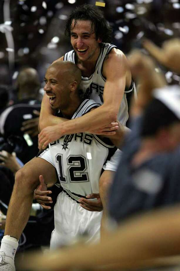 Manu Ginobili jumps on Bruce Bowen at the end of game 7 of the NBA Finals at the SBC Center in San Antonio,  June 23, 2005. ( JERRY LARA STAFF ) Photo: JERRY LARA, Express-News / SAN ANTONIO EXPRESS-NEWS