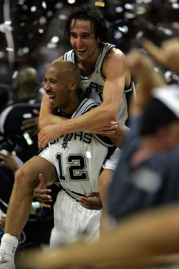 Manu Ginobili jumps on Bruce Bowen at the end of game 7 of the NBA Finals at the SBC Center in San A