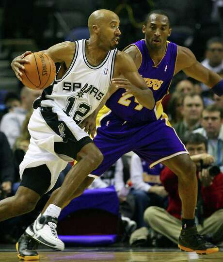 Spurs' Bruce Bowen drives around Lakers' Kobe Bryant during first half action Wednesday Jan. 17, 200