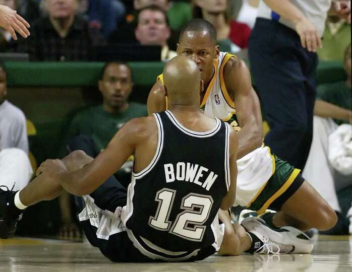 Seattle SuperSonics' Ray Allen, back, reacts to San Antonio Spurs' Bruce Bowen during the second qua