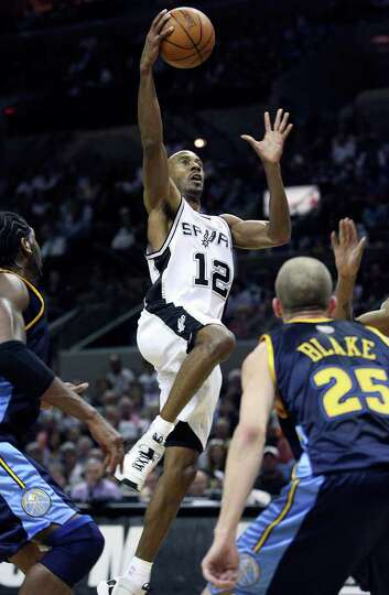 Bruce Bowen gets a layup in the second half against Denver Wednesday night at the AT&T Center. SPURS