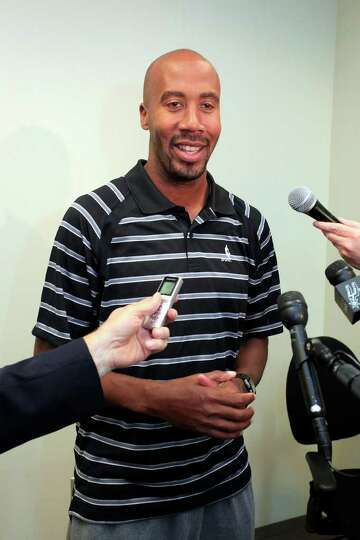SPORTS; BOWEN JERSEY JMS; 01/23/12; Bruce Bowen talks to the media regarding the Spurs' announcement