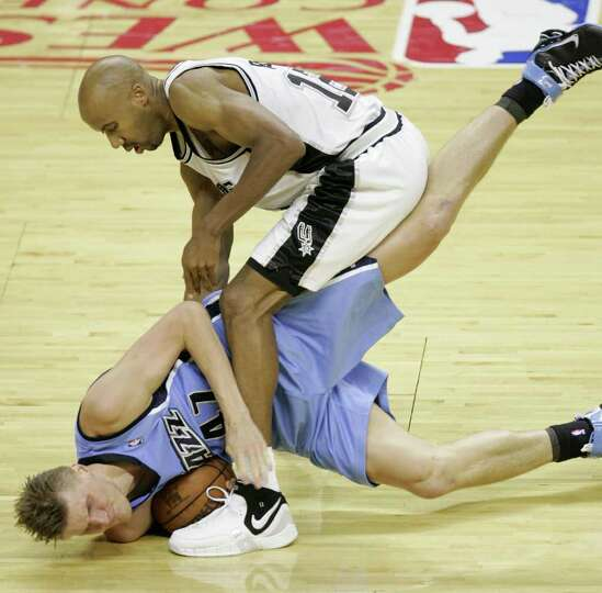 Spurs' forward Bruce Bowen (12) and  Jazz forward Andrei Kirilenko, of Russia, (47) battling for the