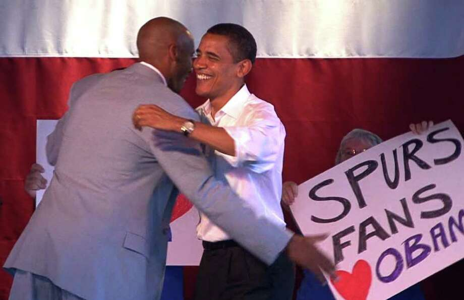 Democratic presidential hopeful Barack Obama, (D-Ill.), right, is embraced by San Antonio Spurs player Bruce Bowen during a campaignsto in San Antonio, Texas, on Sunday, June 24, 2007. BILLY CALZADA / STAFF Photo: BILLY CALZADA, Express-News