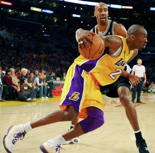 Lakers' Kobe Bryant drives around Spurs' Bruce Bowen during second half action of game 5 in the NBA