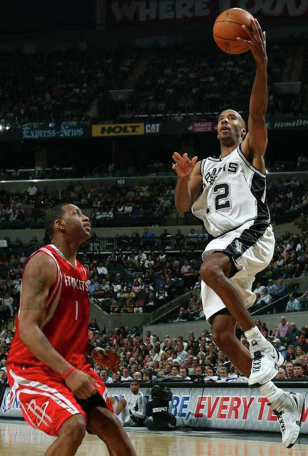 Spurs' Bruce Bowen shoots over Rockets' Tracy McGrady during second half action Sunday March 30, 2008 at the AT&T Center.  The Spurs won 109-88. (PHOTO BY EDWARD A. ORNELAS/STAFF) Photo: EDWARD A. ORNELAS, Express-News / SAN ANTONIO EXPRESS-NEWS