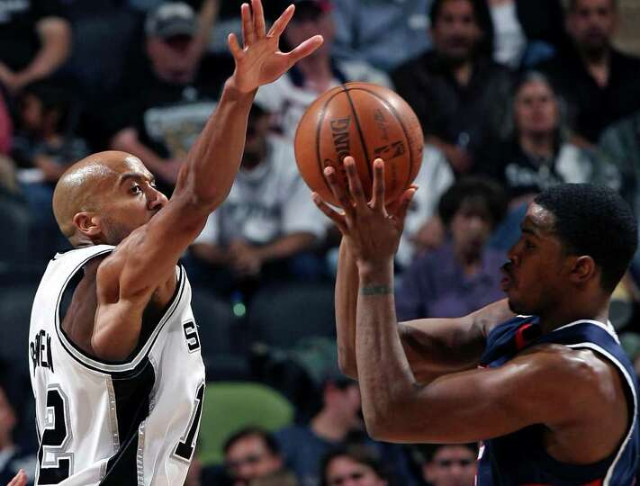 Bruce Bowen moves to block the ball against Atlanta's Joe Johnson in the first half Monday at the AT