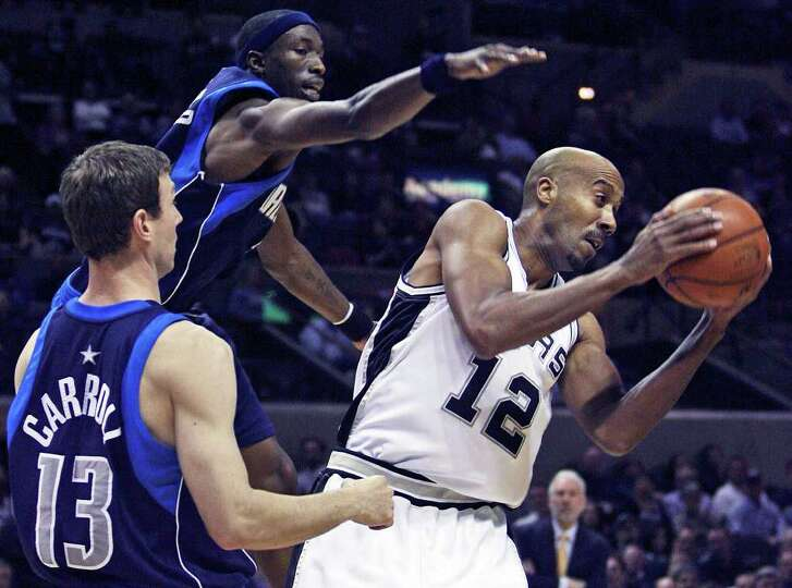 Bruce Bowen grabs a rebound as the Spurs play the Dallas Mavericks at the AT&T Center February 24, 2