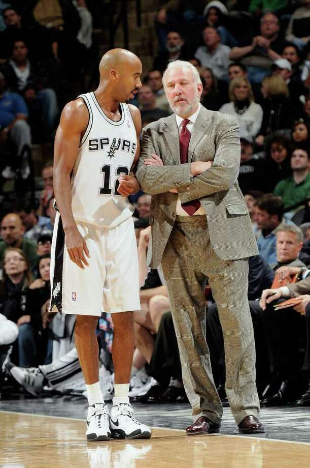 Bruce Bowen #12 of the San Antonio Spurs talks to Head Coach Gregg Popovich during the game against the Atlanta Hawks at the AT&T Center on December 10, 2008 in San Antonio, Texas.  The Spurs won 95-89.  NOTE TO USER: User expressly acknowledges and agrees that, by downloading and/or using this Photograph, user is consenting to the terms and conditions of the Getty Images License Agreement. Mandatory Copyright Notice: Copyright 2008 NBAE  (Photo by D. Clarke Evans/NBAE via Getty Images) Photo: D. Clarke Evans, Express-News / 2008 NBAE