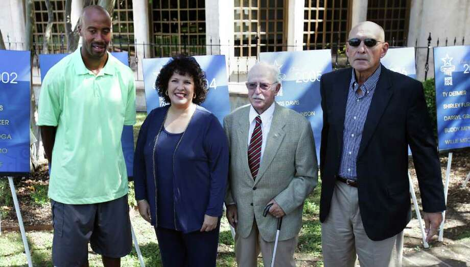 San Antonio Sports Hall of Fame announces it's Class of 2012 with the names of (left to right) Brue Bowen, Leticia Morales-Bissaro, Lt. Col. John Russell, and Stan Bonewitz, Sr., at the Dominion Country Club. Monday, Oct. 17, 2011.  David Hill, also selected, was not present for the announcement.   Photo Bob Owen/rowen@express-news.net Photo: BOB OWEN, Express-News / rowen@express-news.net