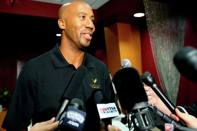 Former Spurs' player Bruce Bowen announces his retirement from the NBA at a news conference at the Y
