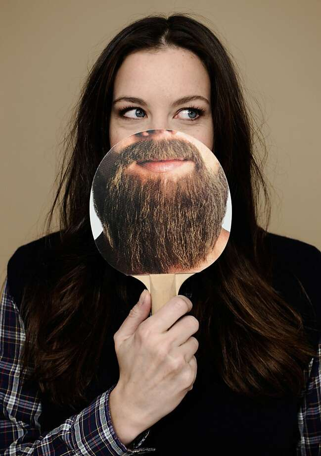 She hides it so well on camera: Millions of women suffer from some sort of facial hair - fine sideburns, peach fuzz on upper lips or, in the case of actress Liv Tyler, full lumberjack beards. (Sundance Film Festival, Utah.) Photo: Larry Busacca, Getty Images