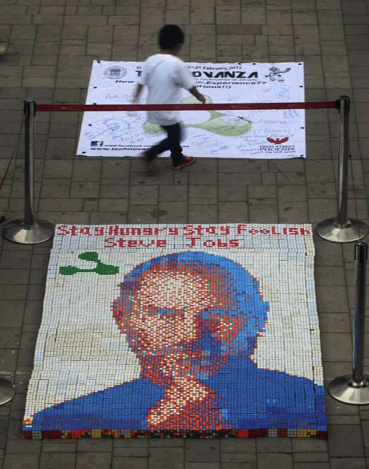 A portrait by technical students of late Apple co-founder Steve Jobs, made from some 1,500 Rubik's cubes, is displayed at the High Street Phoenix Mall in Mumbai, India, this month. Photo: PUNIT PARANJPE / AFP