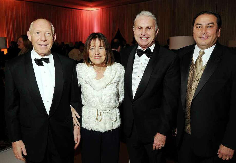 From left: Bill and Andrea White with Mark Wallace and Massey Villarreal at the Opportunity Ball benefitting Houston Community Collefe at the InterContinental Houston Friday Jan.  08,2010.(Dave Rossman/For the Chronicle) Photo: Dave Rossman / Freelance