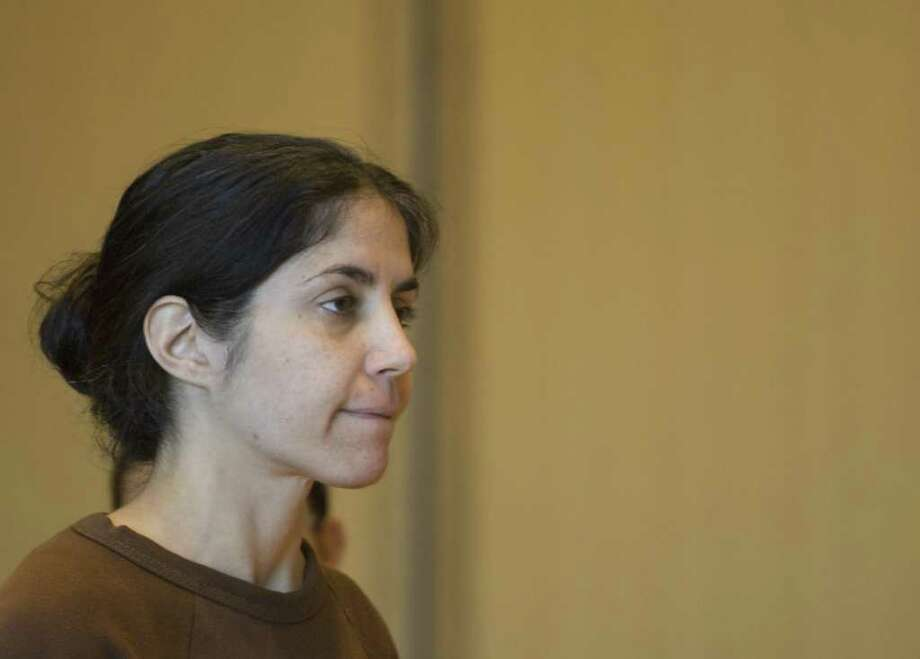 Sheila Davalloo at her arraignment for the murder of Anna Lisa Raymundo at Superior Court at Stamford in Stamford on Tuesday, Dec. 30, 2008. A decade after Raymundo was killed, Davalloo will represent herself against a murder charge in a trial that begins Tuesday, Jan. 24, 2012 at state Superior Court in Stamford. Authorities say Davalloo killed Raymundo to eliminate her rival in a love-triangle involving a male co-worker at Purdue Pharma in Stamford.  Chris Preovolos/Staff file photo Photo: CHRIS PREOVOLOS, ST