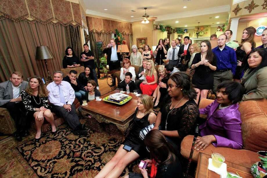 "Family, friends, television producers and invited guests gather to watch the series premier at the Swan Family's private screening of CMT's ""Swanderosa,"" a reality television show filmed on the family's 18-acre estate, Friday, January 20, 2012. Photo: J. MICHAEL SHORT, SPECIAL TO THE EXPRESS-NEWS / THE SAN ANTONIO EXPRESS-NEWS"