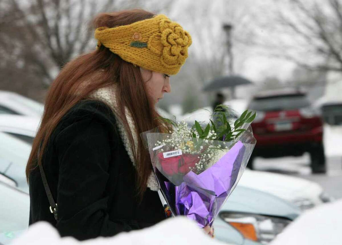 Mourners attend a memorial service in Fairfield for Eva Block, a Marist college student from Woodbridge, on Monday, January 23, 2012. Block was killed in a house fire near campus in Poughkeepsie, N.Y. early Saturday morning. She was born in Bridgeport.