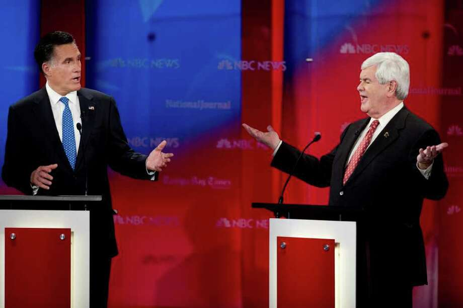 Republicans Mitt Romney and Newt Gingrich tangled repeatedly at the debate at the University of South Florida in Tampa. Photo: AFP/Getty Images, Paul J. Richards / 2012 AFP