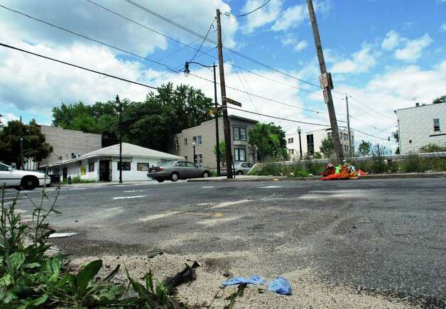 "The crash scene at the intersection of First Street and Henry Johnson Boulevard where Harrison Carnevale, age 17, died from injuries sustained following a car crash on July 2, 2007. Carnevale was killed when a vehicle driven by a woman fleeing police broadsided his vehicle. Carnevale's parents waged a years-long legal battle against the city, which said it ""inadvertently"" withheld seven witness statements. The parents' lawsuit alleged police continued their pursuit, with sirens off, after the chase was terminated for public safety reasons. Photo: WW / ALBANY TIMES UNION"