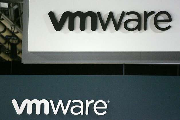 VMware Inc. signage is displayed at the EMC World conference in Las Vegas, Nevada, U.S., on Tuesday, May 10, 2011. EMC Corp., the world's biggest maker of storage computers, reported a 28 percent gain in first-quarter profit last month as companies increased spending on data centers capable of delivering tasks through the Internet. Photographer: Ronda Churchill/Bloomberg Photo: Ronda Churchill, Bloomberg