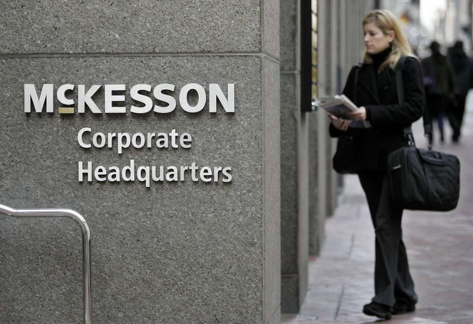 A woman walks into McKesson Corporation's headquarters in San Francisco, Thursday, Jan. 31, 2008.  McKesson is expected to release quarterly earnings after the market closes.  (AP Photo/Paul Sakuma) Photo: Paul Sakuma, AP