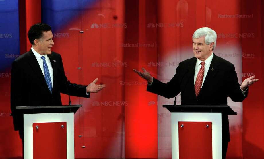 Mitt Romney, left, and Newt Gingrich tussled repeatedly at Monday night's  Republican presidential debate in Tampa, Fla. Photo: Paul Sancya / AP