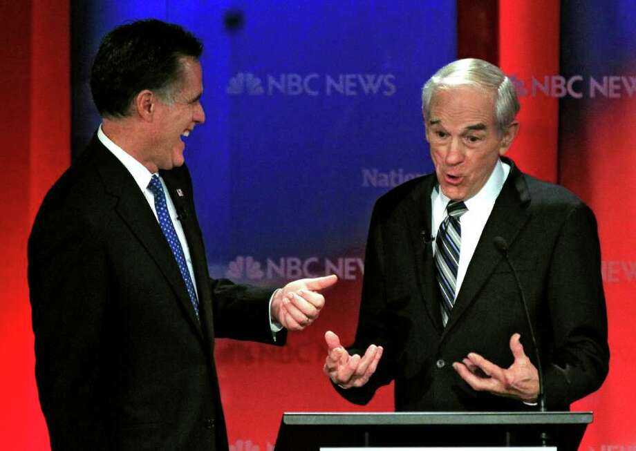Mitch Romney and Ron Paul joke with each other during a break in a presidential debate in January. Photo: Chris O'Meara / AP