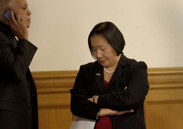 Mayor Jean Quan and others waited for the press conference to begin. Oakland officials including Mayor Jean Quan presented an amended policy budget to balance the city budget following the loss of Redevelopment funding Monday January 23, 2012. Photo: Brant Ward, The Chronicle