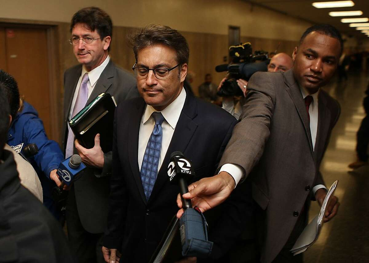 Sheriff Ross Mirkarimi (middle) appearing for his hearing at the Hall of Justice in San Francisco, Calif., with his lawyer Robert Waggner (back left) on Monday, January 23, 2012.