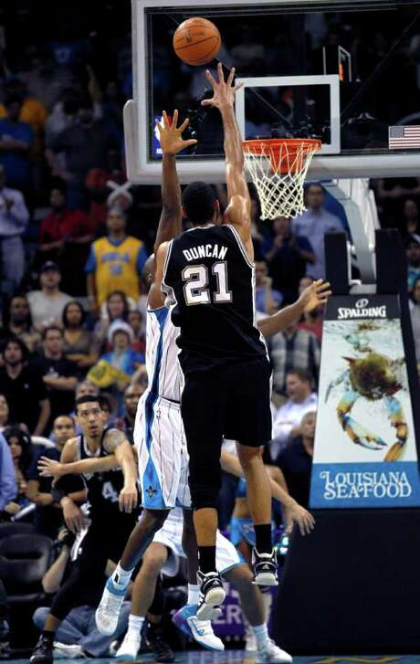 The Spurs' Tim Duncan lofts the game-winner over the Hornets' Emeka Okafor with 1.4 seconds left. Photo: Gerald Herbert / AP