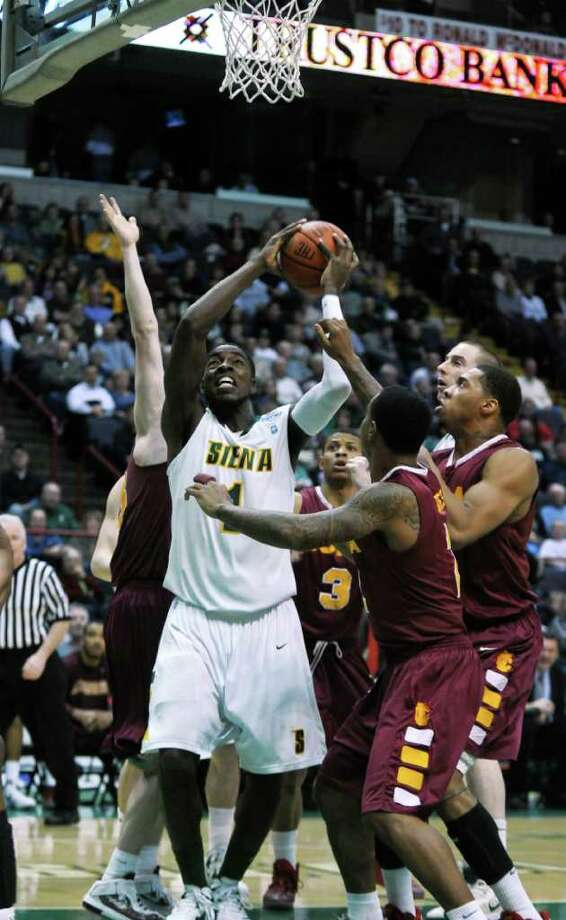 Siena's OD Anosike is surrounded by Iona defenders during their first half of Siena's 65-62 upset victory at the Times Union Center on Monday night Jan. 23, 2012 in Albany, NY. Anoskie scored 17 points in the game.  (Philip Kamrass / Times Union ) 1 Photo: Philip Kamrass / 00015373I