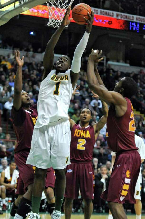 Siena's OD Anosike is surrounded by Iona defenders during their first half of Siena's 65-62 upset victory at the Times Union Center on Monday night Jan. 23, 2012 in Albany, NY. Anosike scored 17 points in the game.  (Philip Kamrass / Times Union ) Photo: Philip Kamrass / 00015373I