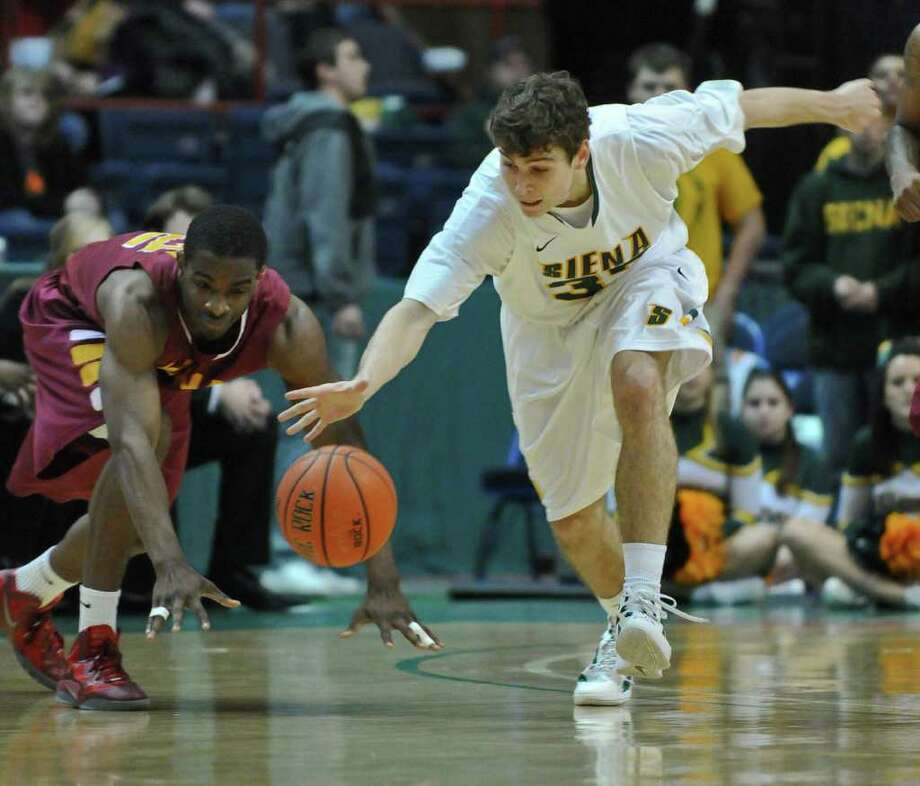 Siena's Rob Poole steals the ball from Iona's Sean Armand before scoring on a layup during their first half of Siena's 65-62 upset victory at the Times Union Center on Monday night Jan. 23, 2012 in Albany, NY. Poole scored 14 points in the game.  (Philip Kamrass / Times Union ) Photo: Philip Kamrass / 00015373I