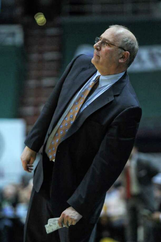 Siena men's basketball head coach Mitch Buonaguro watches a play  during the second half of Siena's 65-62 upset victory over Iona at the Times Union Center on Monday night Jan. 23, 2012 in Albany, NY.   (Philip Kamrass / Times Union ) Photo: Philip Kamrass / 00015373I