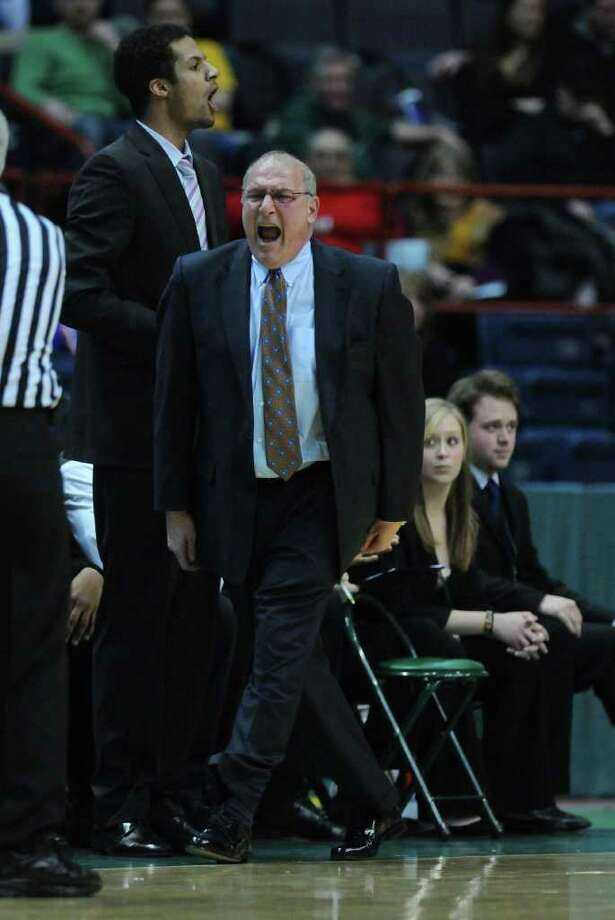Siena head coach Mitch Buonaguro yells  during the first half of Siena's 65-62 upset victory over Iona at the Times Union Center on Monday night Jan. 23, 2012 in Albany, NY.   (Philip Kamrass / Times Union ) Photo: Philip Kamrass / 00015373I