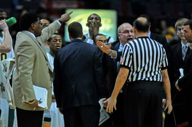 Siena head coach Mitch Buonaguro yells at an official during the first half of Siena's 65-62 upset victory over Iona at the Times Union Center on Monday night Jan. 23, 2012 in Albany, NY.   (Philip Kamrass / Times Union ) Photo: Philip Kamrass / 00015373I
