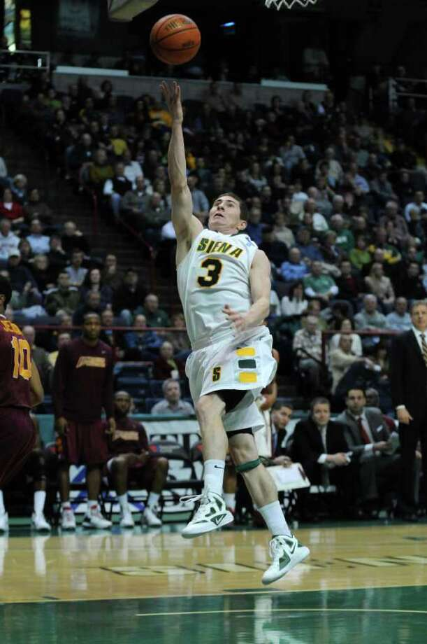 Siena's Kyle Downey puts up a shot during the first half of Siena's 65-62 upset victory over Iona at the Times Union Center on Monday night Jan. 23, 2012 in Albany, NY.   (Philip Kamrass / Times Union ) Photo: Philip Kamrass / 00015373I