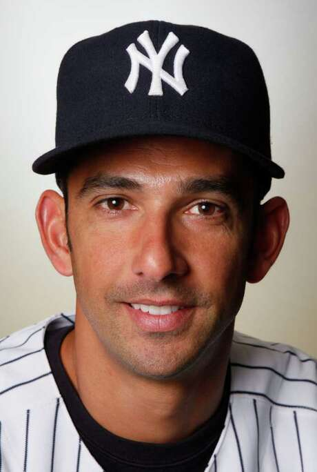 FILE - This 2010 file photo shows Jorge Posada of the New York Yankees baseball team. The Yankees say Posada is going to announce his retirement Tuesday, Jan. 24, 2012 at Yankee Stadium. The 40-year-old five-time All-Star catcher will end his 17-year big league career with the team that drafted him rather than pursue another team. The Yankees announced Posada's decision in a statement Monday, Jan. 23, 2012. (AP Photo/Kathy Willens) Photo: Kathy Willens / AP2010