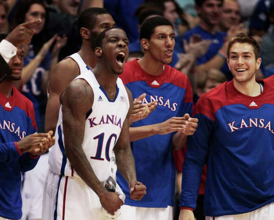 Kansas' Tyshawn Taylor (10), who scored 17 points, leads the Kansas bench in cheers as the Jayhawks take control of the game in the second half. Photo: Orlin Wagner / AP