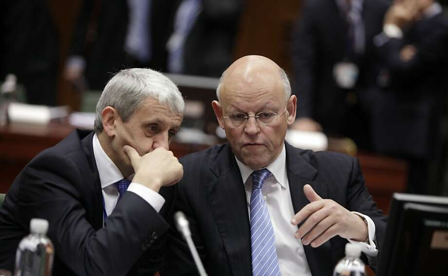 Slovakian Foreign Minister Mikulas Dzurinda, left, speaks with Dutch Foreign Minister Uri Rosenthal during a meeting of EU foreign ministers at the EU Council building in Brussels on Monday, Jan. 23, 2012. EU foreign ministers are set to impose an embargo on Iranian oil to pressure the country to resume talks on its nuclear program. (AP Photo/Virginia Mayo) Photo: Virginia Mayo, Associated Press