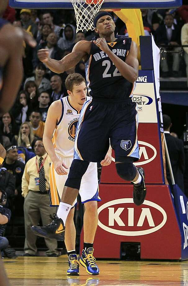 Memphis Grizzlies small forward Rudy Gay (22) celebrates in front of Golden State Warriors power forward David Lee (10) during the fourth quarter of an NBA basketball game in Oakland, Calif., Monday, Jan. 23, 2012. The Grizzlies won 91-90. (AP Photo/Jeff Chiu) Photo: Jeff Chiu, Associated Press