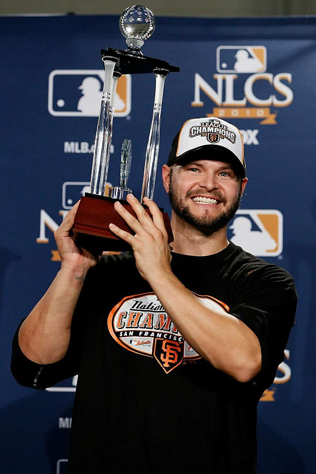 PHILADELPHIA - OCTOBER 23: Cody Ross #13 of the San Francisco Giants celebrates with the NCLS MVP trophy after defeating the Philadelphia Phillies 3-2 and winning the pennant in Game Six of the NLCS during the 2010 MLB Playoffs at Citizens Bank Park on October 23, 2010 in Philadelphia, Pennsylvania.