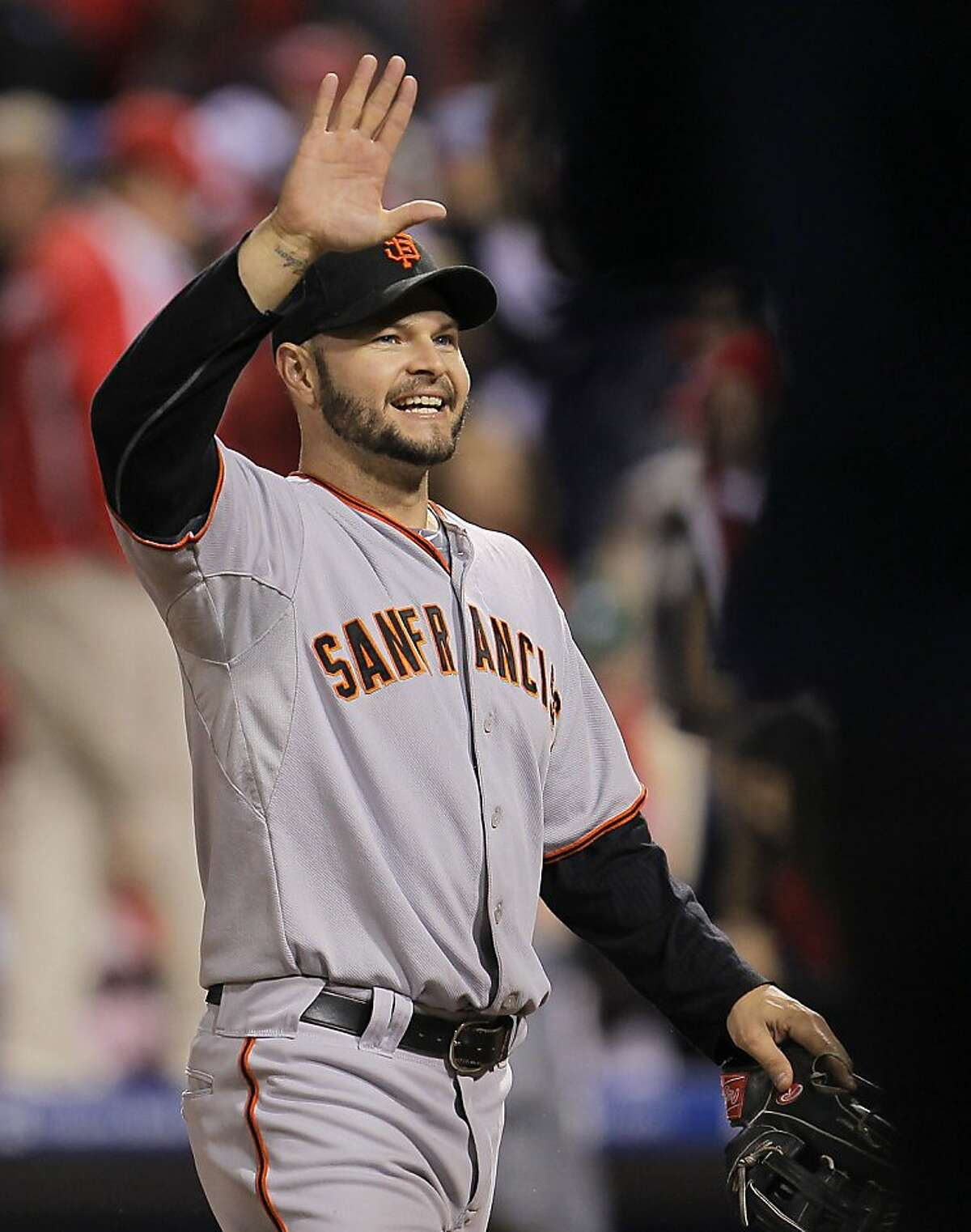 The Giants' Cody Ross celebrates their win against the Philadelphia Phillies in Game 1 of the National League Championship Series on Saturday at Citizens Bank Park in Philadelphia.